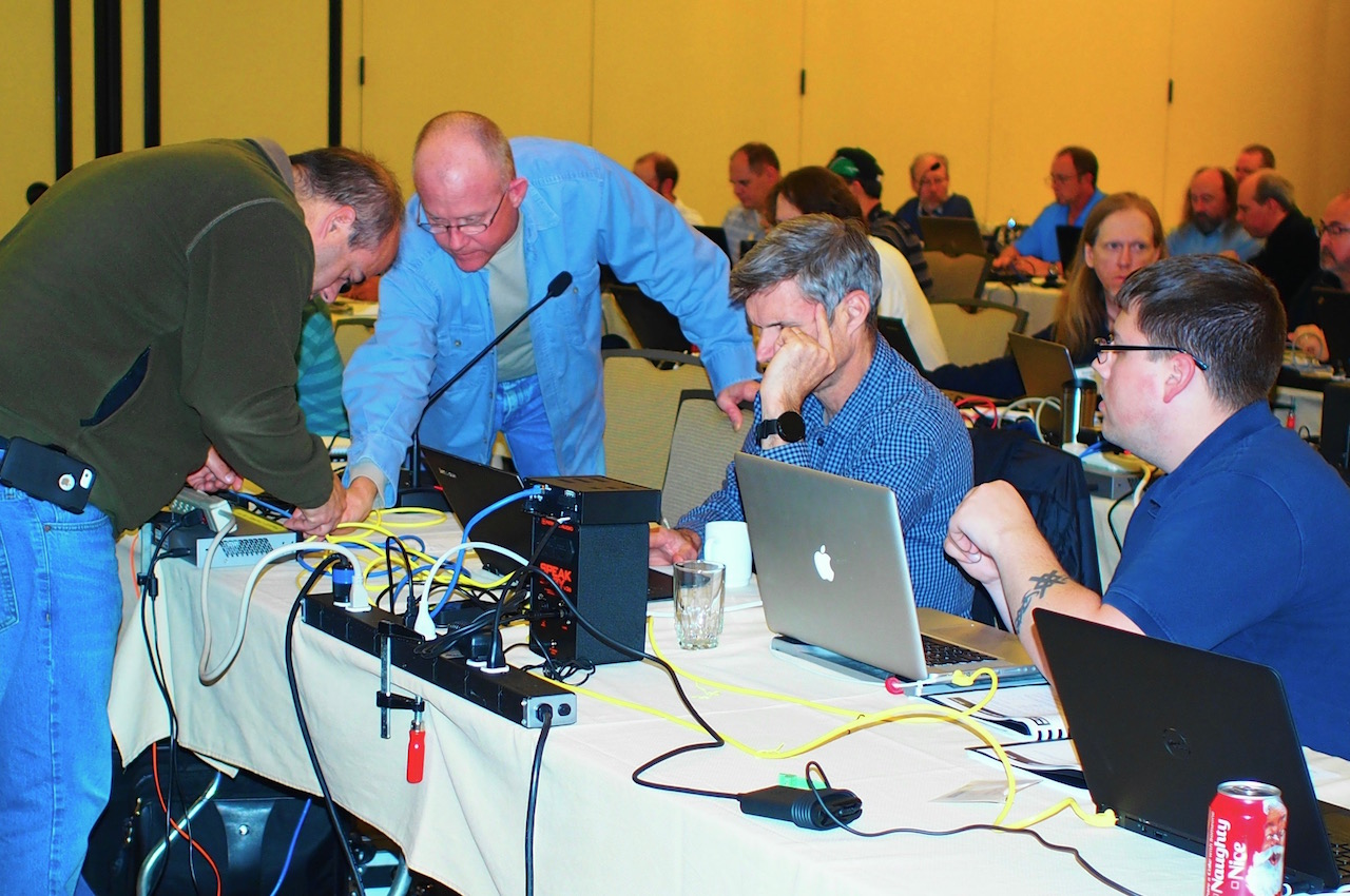 Photo of attendees hooking up a network